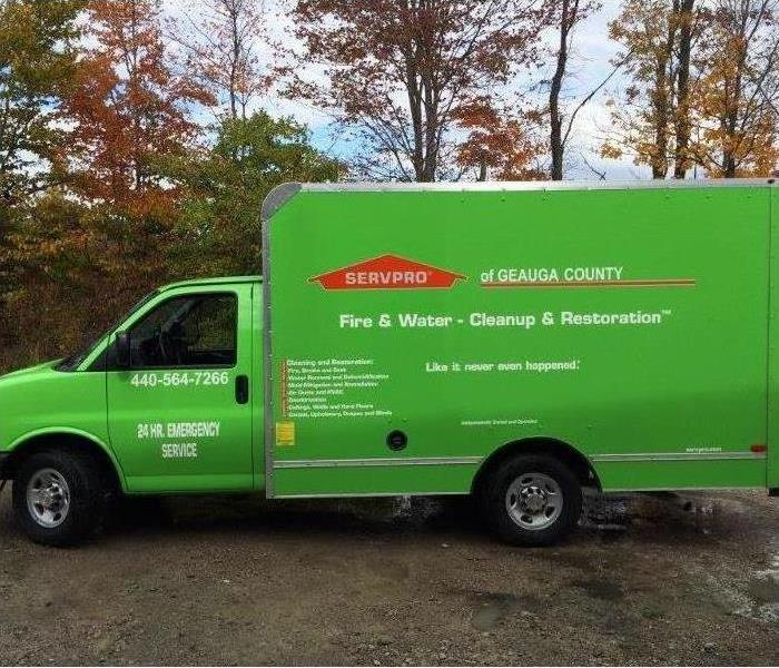 SERVPRO truck parked in front of trees