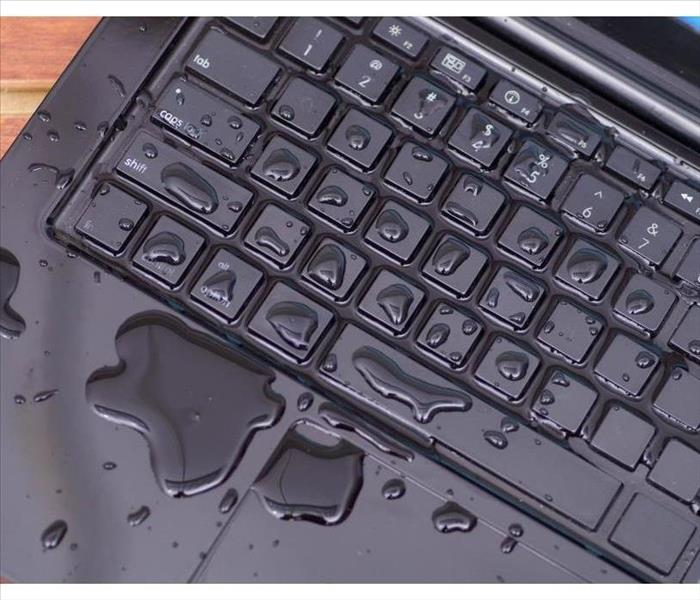 The keyboard of a computer with water